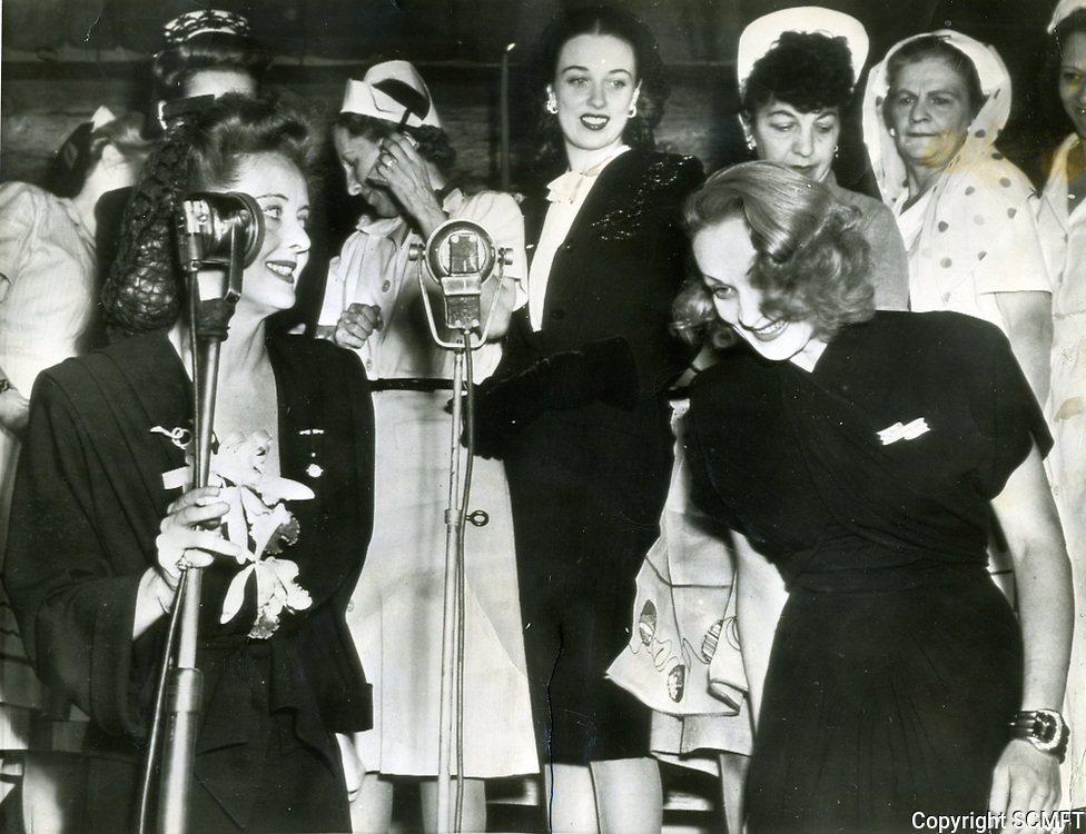 1943 Bette Davis and Marlene Dietrich on stage during the Hollywood Canteen's first birthday