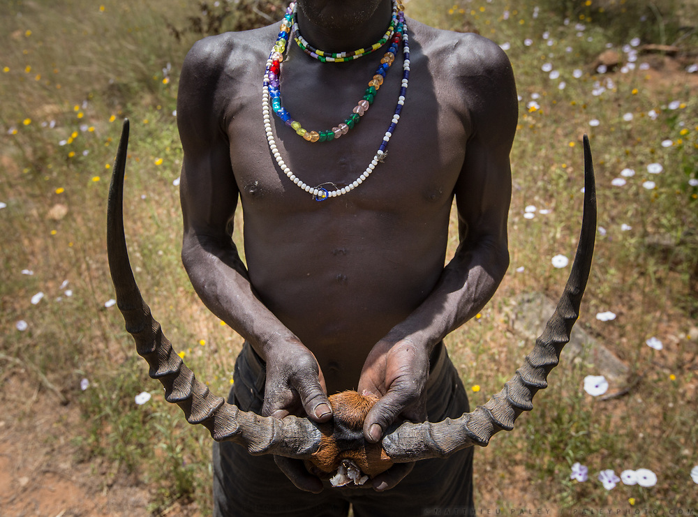 Isaya shows me a recently killed Gazelle. At the Hadza camp of Senkele.