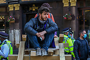 Members of Extinction Rebellion Youth Cambridge chained themselves on a bamboo lock-on, blocking the road outside Baringa Partners building in London on Thursday, Sept 10, 2020 - in an attempt to highlight the involvement of Schlumberger Limited in what they call 'ecocide'. Schlumberger is an oilfield services company working in more than 120 countries and has four principal executive offices located in Paris, Houston, London, and The Hague. An article at the Guardian suggests that it's ubiquitous in fossil fuel operations across the world, has more staff than Google, turns over more than Goldman Sachs, and is worth more than McDonald's – yet you won't have heard of it. XR Youth of Cambridge said that the British government gave 'Schlumberger' - a no-strings-attached £150 million bailout loan as it was laying off a fifth of its global workforce. Another activist added: 'Schlumberger is hiding in plain sight here in Westminster. Every day, hundreds of people walk past this building with no idea that they're on the doorstep of a climate crime scene.'<br /> Environmental nonviolent activists group Extinction Rebellion enters its 10th and final day of continuous ten days protests to disrupt political institutions throughout peaceful actions swarming central London into a standoff, demanding that central government obeys and delivers Climate Emergency bill. (VXP Photo/ Vudi Xhymshiti)