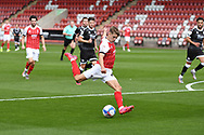 George Lloyd (19) of Cheltenham Town fires in a shot during the EFL Sky Bet League 2 match between Cheltenham Town and Crawley Town at Jonny Rocks Stadium, Cheltenham, England on 10 October 2020.