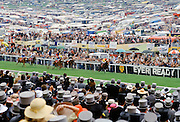 Crowds of spectactors in front of the Grandstand at Epsom Racecourse for Derby Day, UK