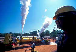 Man overlooks CO2 fracking site in an East Texas oil field.