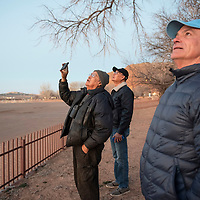 Scott Stearns, director of public affairs at White Sands Missile Range, right, and brothers Melvin Ashley, center, and Tony Ashley watch the launch of a Black Dagger target missile Thursday morning from Red Rock Park in Churchrock.