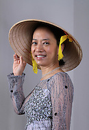 Amanda Phan shows off a traditional dress she had made during a recent visit to Vietnam. Phan left Vietnam as a refugee when she was a child and went on to graduate dental school at Baylor University before establishing a practice in Plano. (Photo by Kevin Bartram)