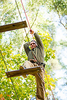 Jeff Potvin makes his way across the wide planks during the Wounded Warrior programs outing at the Tree Top Adventure Ropes Course at Gunstock on Monday afternoon.  (Karen Bobotas/for the Laconia Daily Sun)