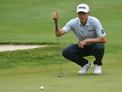 July 15, 2018 - Silvis, Illinois, U.S. - SILVIS, IL - JULY 15:  Mackenzie Hughes lines up his putt on the #1 green during the final round of the John Deere Classic on July 15, 2018, at TPC Deere Run, Silvis, IL.  (Photo by Keith Gillett/Icon Sportswire) (Credit Image: © Keith Gillett/Icon SMI via ZUMA Press)