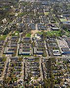 Nederland, Drenthe, Emmen, 01-05-2013; Angelslo, nieuwbouwwijk uit de jaren zestig van de twintigste eeuw, wederopbouwperiode. Overzicht in oostelijke richting.<br /> Kenmerkend is de indeling in buurten en woonerven, scheiding van functies (wonen, werken, verkeer). Rationalistische architectuur, groen en ruimte. <br /> New residential area in Emmen built in the sixties during the period of Reconstruction after World War II, characteristic of the division into neighborhoods and residential precincts, separation of functions (living, working, traffic). Rationalist architecture.<br /> luchtfoto (toeslag op standard tarieven)<br /> aerial photo (additional fee required)<br /> copyright foto/photo Siebe Swart