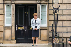 Prime Minister and Conservative Leader, Boris Johnson visits Bute House to meet First Minister of Scotland, Nicola Sturgeon. Earlier in the day, Johnson announced £300m of funding for projects to boost the economy in Scotland, Wales and Northern Ireland.<br /> <br /> Pictured: FM Nicola Sturgeon smiles as the awaiting crowds shouts at the Prime Minister