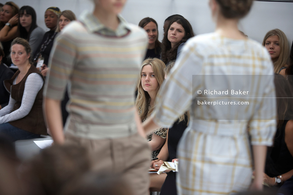 Models scrutinized by media at British couture designer Margaret Howell's Autumn fashion show in her design studio