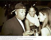Russell Simmons, Veronica Webb and Sophia Coppola.<br />The Vanity Fair Oscar Night Party Mortons,  Los Angeles. 25 March 1996. Film 96205f35<br />© Copyright Photograph by Dafydd Jones<br />66 Stockwell Park Rd. London SW9 0DA<br />Tel 0171 733 0108 www.dafjones.com