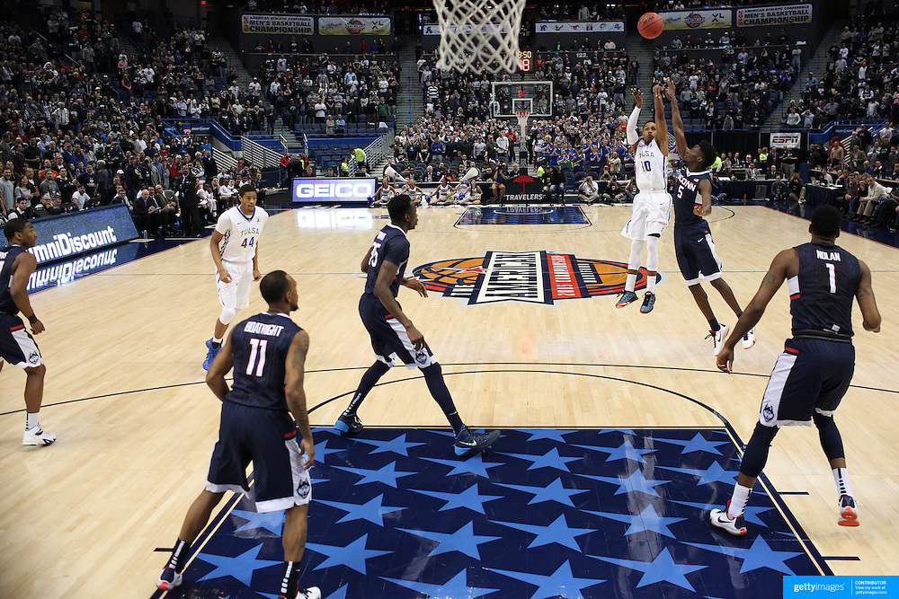 James Woodard, Tulsa, shoots for three over Daniel Hamilton, UConn, during the UConn Huskies Vs Tulsa Semi Final game at the American Athletic Conference Men's College Basketball Championships 2015 at the XL Center, Hartford, Connecticut, USA. 14th March 2015. Photo Tim Clayton