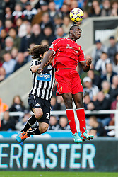 Mario Balotelli of Liverpool heads the ball as Fabricio Coloccini of Newcastle United challenges - Photo mandatory by-line: Rogan Thomson/JMP - 07966 386802 -01/11/2014 - SPORT - FOOTBALL - Newcastle, England - St James' Park - Newcastle United v Liverpool - Barclays Premier League.