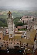San Gimignano tower in the rain, Tuscany, Italy.