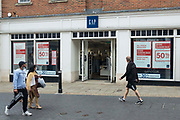 Store closing sale posters are pictured in the window of a branch of the fashion chain store Gap on 2nd July 2021 in Windsor, United Kingdom. Gap has announced that it will close its 81 stores in the UK and Ireland by early autumn.