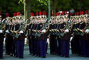 French soldiers with fixed bayonets in parade for Remembrance Day at the Arc de Triomphe in Paris, France