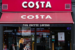 © Licensed to London News Pictures. 03/09/2020. London, UK. A woman walks past Costa in north London as the coffee chain Costa Coffee announced that up to 1,650 roles are at risk of being cut due to the impact of the coronavirus pandemic.Photo credit: Dinendra Haria/LNP