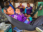 07 MARCH 2014 - MAE SOT, TAK, THAILAND: Motorcycle taxi drivers wait for fares in Mae Sot, Thailand. Motorcycles are frequently used as taxi in Thailand and other countries in Southeast Asia.     PHOTO BY JACK KURTZ