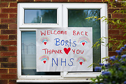 © Licensed to London News Pictures. 27/04/2020. London, UK. A 'Welcome Back Boris. Thank you NHS' sign displayed in a window in a house in north London. British Prime Minister Boris Johnson returns back to work after recovering from COVID-19. Photo credit: Dinendra Haria/LNP