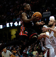 PHOTO BY DAVID RICHARD.Dwayne Wade of the Miami Heat takes the ball through the lane against Cleveland April 1, 2006.