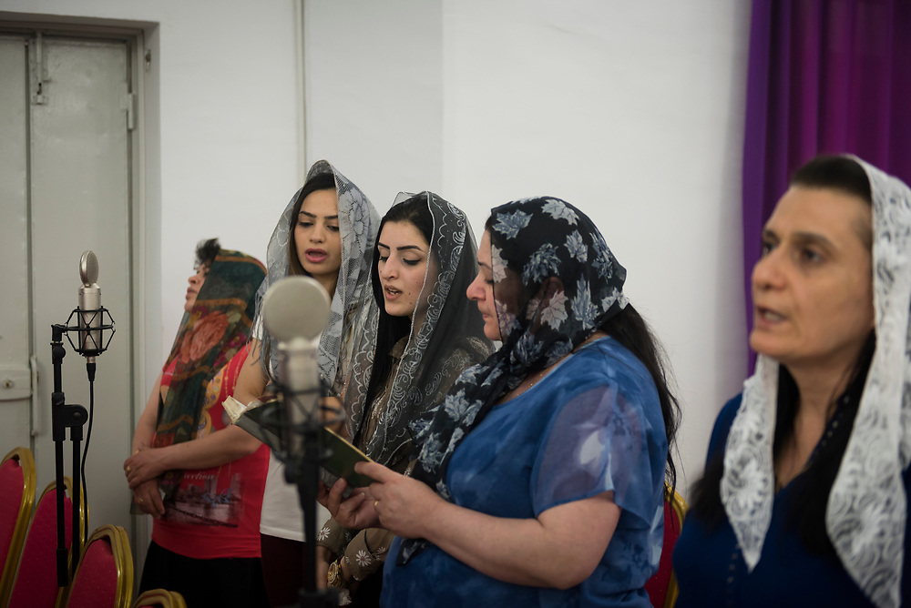 A women's choir sings during a service at St. John the Baptist church (Ancient Church of the East) in Kirkuk, Iraq. (May 21, 2017)