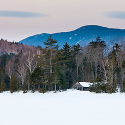 A cabin on the shore of First West Branch Pond at West Branch Pond Camps near Greenville, Maine. Winter.