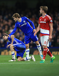 8 May 2017 - Premier League - Chelsea v Middlesbrough - Marcos Alonso of Chelsea places a flaming hand on the head of Diego Costa - Photo: Marc Atkins / Offside.