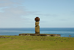 Chile, Easter Island: Statue or moai on a platform or ahu called Ahu Tahai, near the town of Hanga Roa.  This statue is unique because it is the only one that is fully restored, with topknot and eyes. .Photo #: ch216-33117.Photo copyright Lee Foster www.fostertravel.com lee@fostertravel.com 510-549-2202