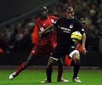 Rivaldo controls the ball ahead of Djimi Traore