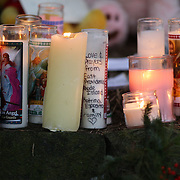 A message of support left at the shrine set up around the towns Christmas tree in Sandy Hook after the mass shootings at Sandy Hook Elementary School, Newtown, Connecticut, USA. 16th December 2012. Photo Tim Clayton