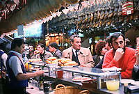 April 1988, Madrid, Spain --- A famous bar in Madrid called the Museo del Jamon, or Museum of Ham, has dozens of hams hanging from the ceiling, mainly of the salt-cured type . --- Image by © Owen Franken/CORBIS