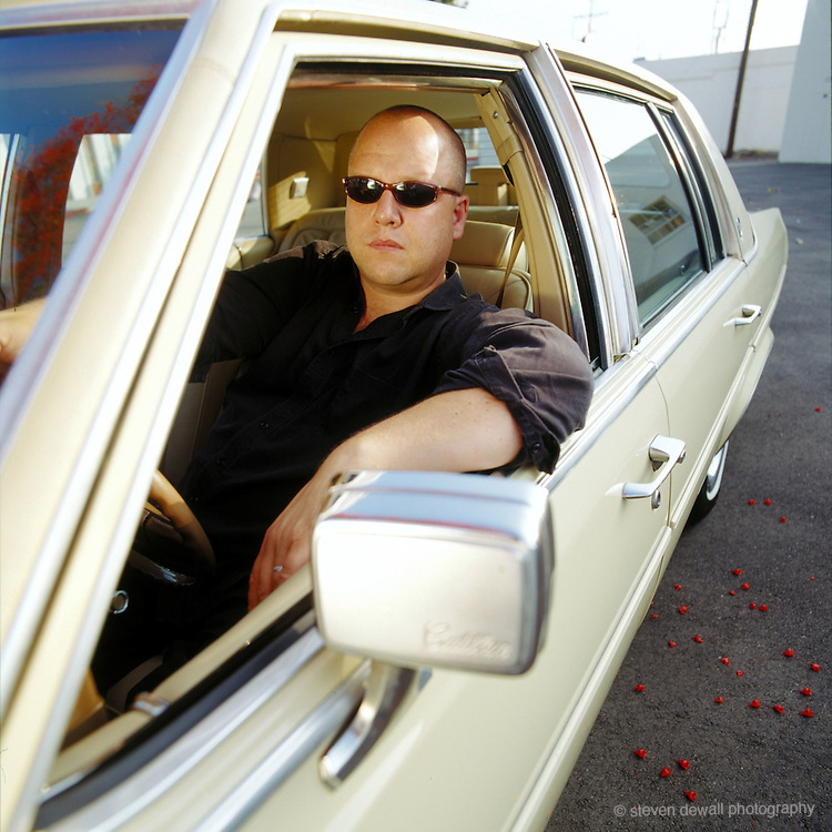 Frank Black- former frontman of the Pixies - photographed with his Cadillac in Los Angeles, CA., 2002