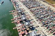 Nederland, Zuid-Holland, Rotterdam, 10-06-2015; Ultra Large Container Carrier Cosco England voor de kade van de Euromax terminal, Yangtzehaven<br /> Container Ship at the quay of the Euromax terminal, Yangtzehaven.<br /> luchtfoto (toeslag op standard tarieven);<br /> aerial photo (additional fee required);<br /> copyright foto/photo Siebe Swart