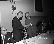 Hovis Family Bakery Competition..1971..23.02.1971..02.23.1971..23rd February 1971..At the Hibernian Hotel, Dublin, Ranks Ireland Ltd.,held the prize giving and celebration lunch for The Hovis Family Bakery Competition winners..Pictured accepting his award from Mr P L Greenwood,Deputy Chairman,Ranks Ireland Ltd is Mr R V McKeever of the Ardee Bread Co Ltd,Ardee,Co Louth..Mr McKeever is the President of The Irish Assoc of Master Bakers.