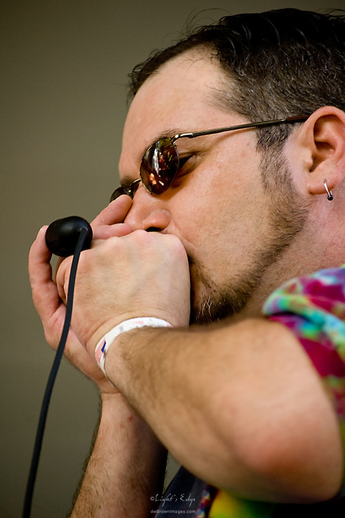 Tim Martz on harmonica during Pitman's 2010 Music & Arts Festival