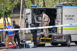 © Licensed to London News Pictures . 03/05/2019. Manchester, UK. Police have cordoned off several square blocks around Piccadilly Gardens in Manchester City Centre following concern that a device . A tent has been erected and a man has been arrested in connection with the incident . Oldham Library has also been evacuated on what is believed to be a connected incident . Photo credit: Joel Goodman/LNP