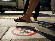 08 JUNE 2018 - SEOUL, SOUTH KOREA: A sign on a Seoul sidewalk warning pedestrians about walking and texting or using smart phones.     PHOTO BY JACK KURTZ