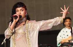 © Licensed to London News Pictures. 28/06/2015. Pilton, UK. FKA Twigs performing at Glastonbury Festival 2015 on Sunday Day 5 of the festival on the West Holts stage.  This years headline acts include Kanye West, The Who and Florence and the Machine, the latter being upgraded in the bill to replace original headline act Foo Fighters.  Photo credit: Richard Isaac/LNP
