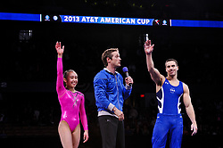 March 2, 2013 - Worcester, Massachusetts, USA - JAKE DALTON and KATELYN OHASHI of the USA salute the fans while master of ceremonies JOHN MACREADY pumps up the fans the 2 gymnasts won the 2013 American Cup at the DCU Center in Worcester, Massachusetts. (Credit Image: © Geoffrey Bolt/ZUMAPRESS.com)