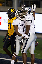 Nevada wide receiver Romeo Doubs (7) is greeted by teammate Melquan Stovall (1) after catching a touchdown pass behind California defensive back Collin Gamble (21) during the second quarter of an NCAA college football game, Saturday, Sept. 4, 2021, in Berkeley, Calif. (AP Photo/D. Ross Cameron)