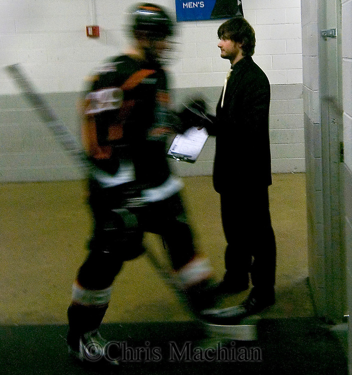 1/5/07 -- Omaha, NE<br />  -- USHL Lancer Nick Petrecki high fives Michal Valent as he enters the locker room after a period of play.<br /> <br /> Photo by Chris Machian, Prairie Pixel Group