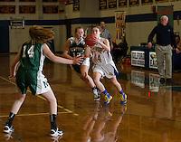 Newfound's Amanda Johnston and Gilford's Brooke Beaudet during NHIAA Division IIII basketball Tuesday evening.  (Karen Bobotas/for the Laconia Daily Sun)