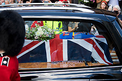 © Licensed to London News Pictures. 10/07/2020. London, UK. The coffin of Dame Vera Lynn passes through the town of Ditchling, East Sussex, ahead of the funeral. The 'Forces' Sweetheart', who died last month aged 103, was famous for singing performances during WW2, which helped raise morale amongst troops abroad. Photo credit: Ben Cawthra/LNP