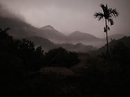 Mountainous landscape in Pu Luong natural reserve, Vietnam, Asia. At dusk clouds hang upon relief and give a mystic atmosphere
