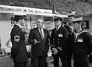 The 1989 Boat Show.   (R89)..1989..10.03.1989..03.10.1989..10th March 1989..Pat the Cope GallagherTD, Minister for the Marine attended the opening of the 1989 Boat Show held at the Point Depot, Dublin. The opening coincided with the minister's birthday...Image shows the Minister taking the time to chat with members of the naval service at the boat show.
