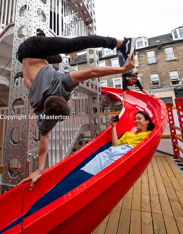 Edinburgh, Scotland, UK; 2 August, 2018. The Assembly's Helter Skelter opens on George Street in Edinburgh as part of the Edinburgh Fringe Festival. Members of the 7-Fingers acrobatic troupe from Quebec enjoy using the new slide