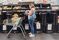 © Licensed to London News Pictures 20/09/2021. <br /> Sevenoaks, A customer shopping at Sainsburys in Sevenoaks, Kent today. Supermarket shortages are continuing across the UK due to a lack of supply and a shortage of lorry drivers which is expected to get a lot worse over the next few months. Photo credit:Grant Falvey/LNP