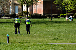 Hillsborough Park Sheffield two two south yorkshire police officers patrol the park during week 4 of the UK Covid-19 Emergency Measures to combat the Coronavirus pandemic<br /> <br /> 15 April 2020<br /> <br /> www.pauldaviddrabble.co.uk<br /> All Images Copyright Paul David Drabble - <br /> All rights Reserved - <br /> Moral Rights Asserted -