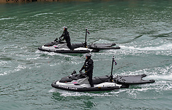 © Licensed to London News Pictures. 22/09/2021. Dover, UK.  Border Force officers on Jet Skis at Dover Harbour in Kent. Migrants are continuing to attempt the crossing from France as the weather improves this week. Photo credit: Stuart Brock/LNP
