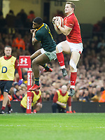 Rugby Union - 2017 Under Armour Series (Autumn Internationals) - Wales vs. South Africa<br /> <br /> Hallam Amos of Wales leaps for the ball from the chip of Rhys Patchell of Wales, at The Principality Stadium (Millennium Stadium), Cardiff.<br /> <br /> COLORSPORT/WINSTON BYNORTH