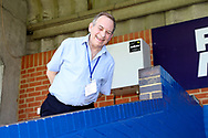 AFC Wimbledon's Laurence Lowne in the press box smiling during the EFL Sky Bet League 1 match between AFC Wimbledon and Shrewsbury Town at the Cherry Red Records Stadium, Kingston, England on 14 September 2019.